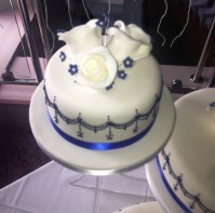 Top tier of blue and white wedding cake design