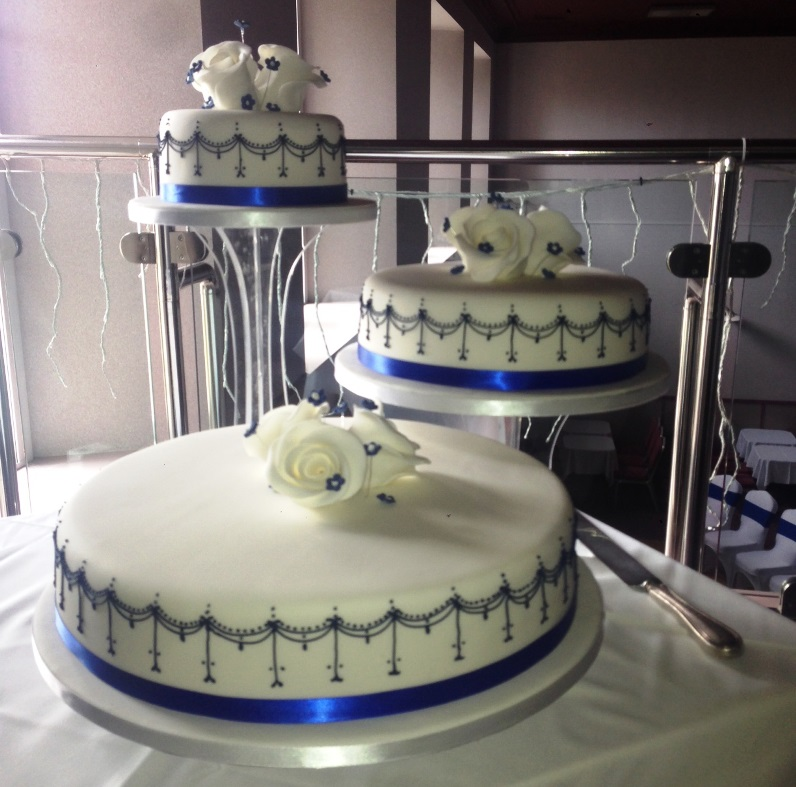 Separated 3-tier blue and white wedding cake